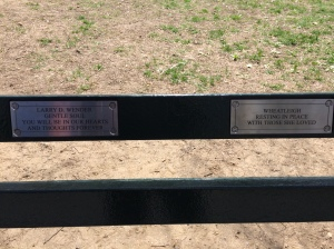 Two of three plaques on two benches, for sweet departed friends.